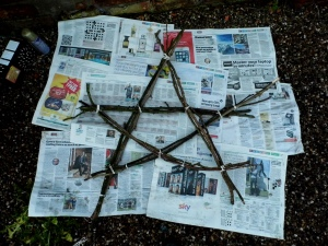 Arrange your stick bundles into a star shape and secure with string.