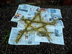 Spray your star (I used a whole can of paint) and sprinkle glitter all over it.