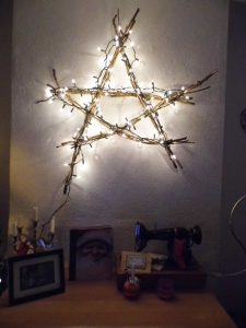 Draped your fairy lights around the star, my fairy lights reached around the star twice. I did try winding the fairy lights around the star but it looked too bulky. Hang on your wall, stand back and admire your handiwork!