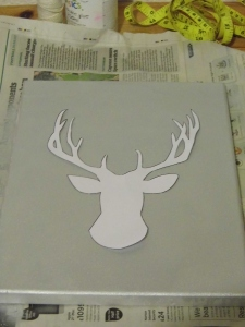 Cut out your stencil and place it onto your canvas. Trace around the stencil with a pencil.
